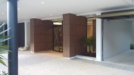 Edifício Residencial IBIZA III: Corredores, halls e escadas modernos por Jrmunch Arquitetura