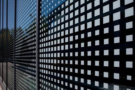 Fassade für Turnhalle:  Schulen von plusEnergieArchitektur