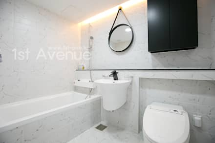 고급스러운 맞춤가구들로 꾸며진 특별함이 가득한 인테리어 : 퍼스트애비뉴의  화장실