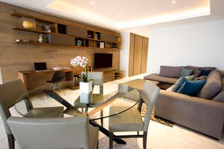 Departamento TG: Salas de estilo moderno por Concepto Taller de Arquitectura