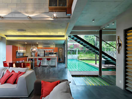 Living Room with connected pool: modern Living room by MJKanny Architect