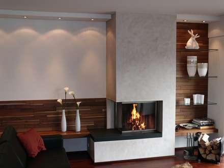 Eckkamin mit angrenzender Sitzgelegenheit: moderne Wohnzimmer von Christoph Lüpken Ofenbau GmbH