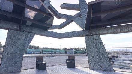 Estación Autobuses: Jardines de estilo industrial de arqubo arquitectos
