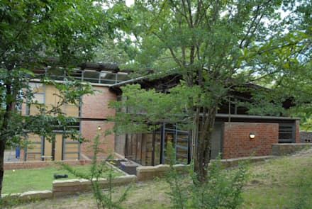 Forest Edge Guest House, Clarens: industrial Houses by Reinier Brönn Architects & Associates