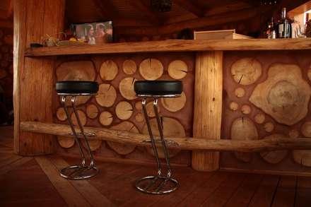 rustic Wine cellar by Organica Design & Build