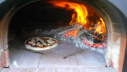cooking pizza: rustic Garden by wood-fired oven