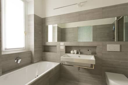 WC IN PIETRA : Bagno in stile in stile Moderno di Luigi Brenna Architetto
