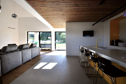 kuchnia z salonem : styl , w kategorii Kuchnia zaprojektowany przez Piotr Stolarek Projektowanie Wnętrz
