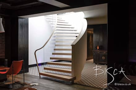 Basement Staircase Design by Bisca: eclectic Media room by Bisca Staircases