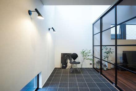静と動: 株式会社スタジオ・チッタ Studio Cittaが手掛けた壁です。