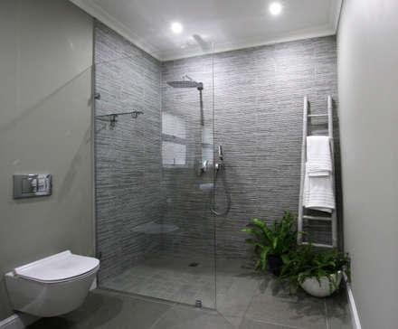 Baños de estilo ecléctico por JSD Interiors