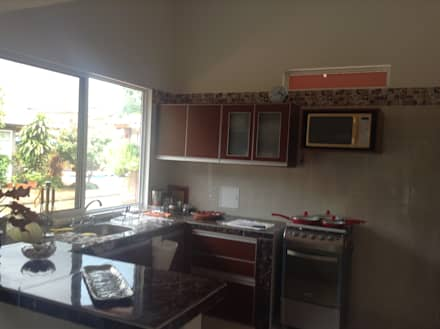 Casa Patricia R. - cocina: Cocinas de estilo moderno por ARQUITECTOnico