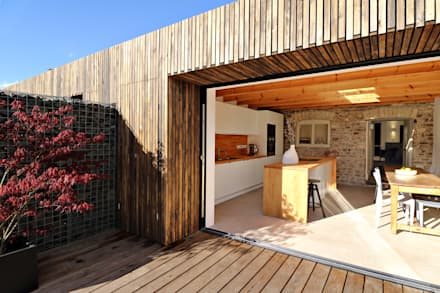 larch cladding:  Terrace by design storey