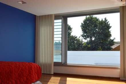 Vivienda V2: Dormitorios de estilo moderno por VANNO arquitectura