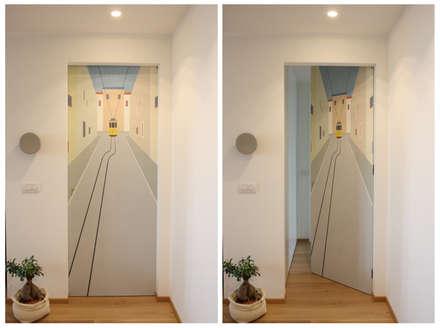 Pasillos y hall de entrada de estilo  por studio ferlazzo natoli