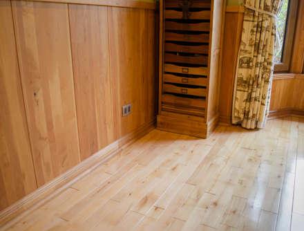 Piso y revestimientos.: Paredes y pisos de estilo rústico por Ignisterra