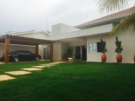Casa L: Casas modernas por au cubo arquitetura