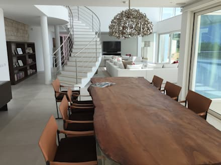 Dining Area: Salas de jantar modernas por Pure Allure Interior