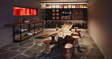 modern Wine cellar by Bau-Fritz GmbH & Co. KG