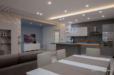 02: Sala da pranzo in stile in stile Moderno di maps_architetti