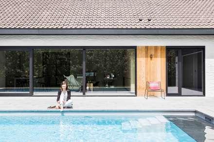 Project K: modern Zwembad door JUMA architects