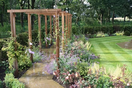 Wooden square arches: modern Garden by Dawn Garden Design