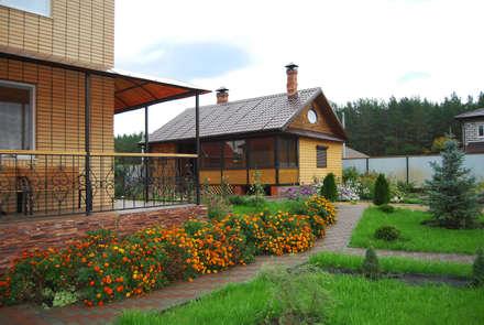 Ландшафтный проект в поселке жареный бугор: Сады в . Автор – Студия архитектуры и дизайна Вояджи Дарьи