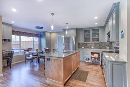 Homestead II Kitchen and Living Room: classic Kitchen by Studio Design LLC