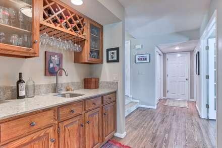 Homestead II Kitchen and Living Room: classic Wine cellar by Studio Design LLC