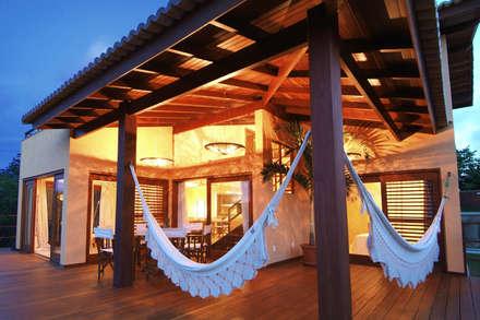 Casas de estilo  por Carlos Ribeiro Dantas Arquitetos Associados