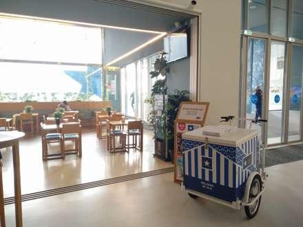Museu Caffé_FCP: Espaços comerciais  por GRAU.ZERO Arquitectura