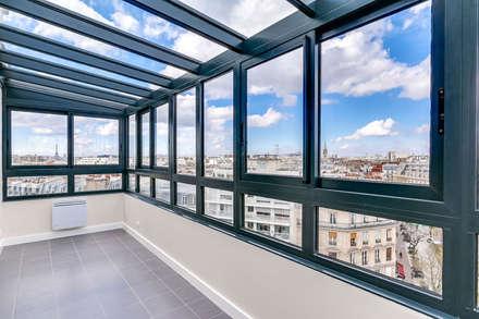 Appartement parisien: Jardin d'hiver de style  par Kaizo Studio