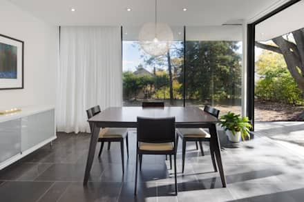 The Hambly House: minimalistic Dining room by dpai architecture inc