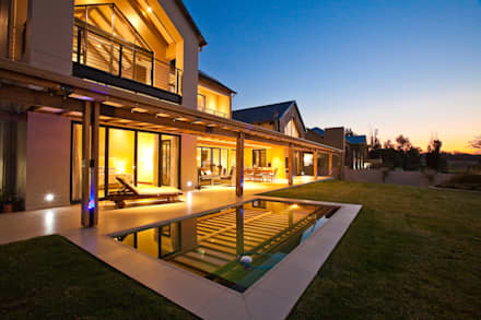 RESIDENCE 1111: rustic Houses by Architects Of Justice