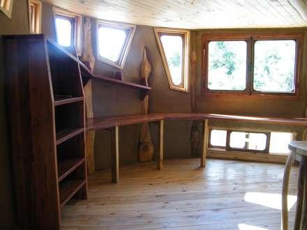 Casa Sol en Rari: Estudios y biblioteca de estilo  por Secrea