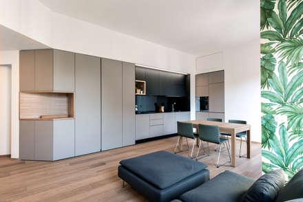 8760 dm2: Sala da pranzo in stile in stile Scandinavo di Tommaso Giunchi Architect