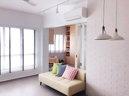 Finished living room area with glass curtain doors: scandinavian Living room by Singapore Carpentry Pte Ltd