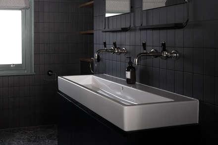 industrial Bathroom by Blankstone