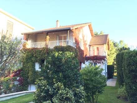 façade sur rue, avant: Maisons de style de style Minimaliste par Eric Rechsteiner