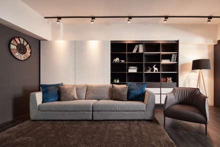 訂製溫暖工業宅,成就單身男子的自在空間:  客廳 by 合觀設計