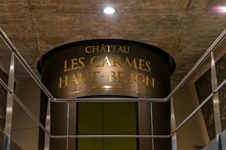 Philippe Starck's new stunning cellar at Château Les Carmes Haut-Brion: modern Wine cellar by Il Pezzo Mancante Srl