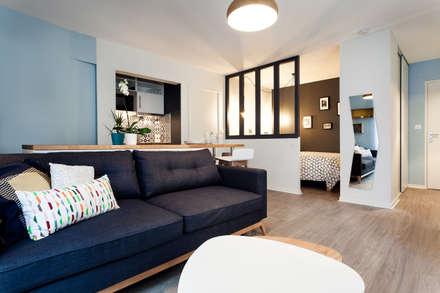 Rénovation complète d'un appartement de 30m²: Salon de style de style Scandinave par MadaM Architecture