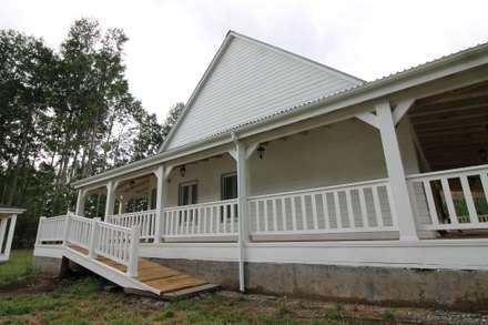 Casa Hott: Terrazas  de estilo  por Kanda arquitectos