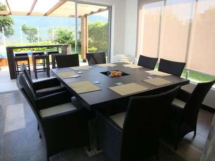 casa moderna chinauta: Comedores de estilo moderno por Mdesign