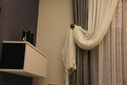 50GR Mimarlık – Cevizlibağ_oturma odası: modern tarz Oturma Odası