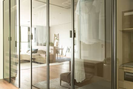All in one Space: modern Dressing room by Sensearchitects_Limited