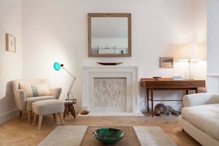 Limestone fireplace: eclectic Living room by Liller Interior