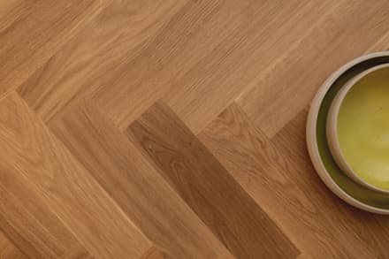 Natural oak herringbone wood floorinh:  Corridor & hallway by Timothy James Interiors