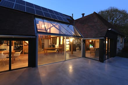 Exterior shot of barn renovation: eclectic Garden by IQ Glass UK
