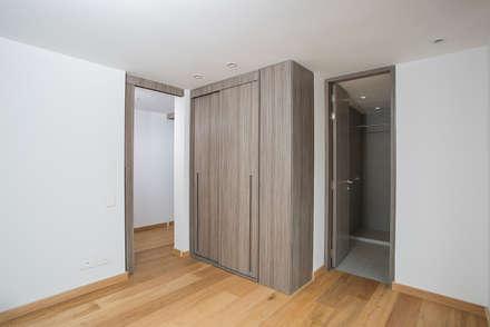 Apto Cr 12 - Cll 102: Habitaciones infantiles de estilo  por Bloque B Arquitectos